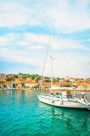 white yacht moored in beautiful small marina at Sali port on Dugi island, Croatia