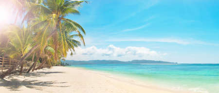 panoramic image of sunny day on white sand tropical beach, Boracay island, the Philippines