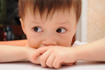 Sad littke boy looking left Stock Photo - 26173212