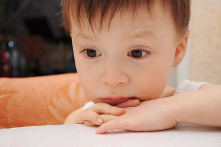 Sad little boy looking down Stock Photo - 26173169