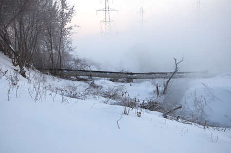streamlet: fog at the winter near the streamlet Stock Photo