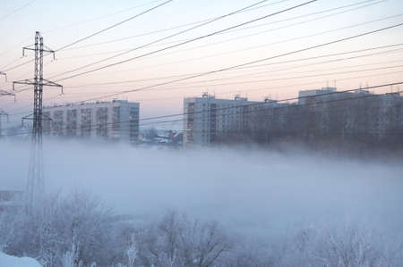 exhalation: Winter city at the fog in Siberia