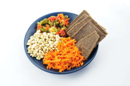 sprouted: Healthy breakfast of sprouted buckwheat, flax breads,roasted peppers and grated carrots