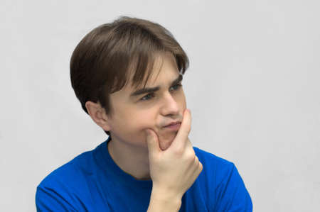 casuals: Thinking young european caucasian man in casuals
