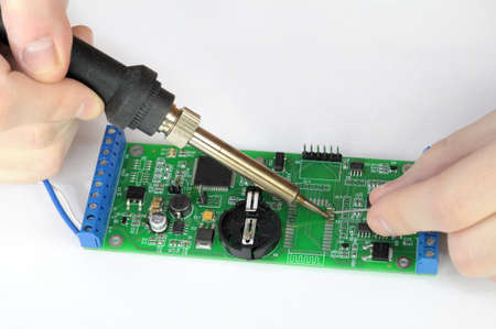 Soldering and repairing pc board photo