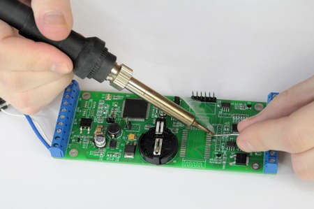 Soldering and repairing pc board with smoke photo