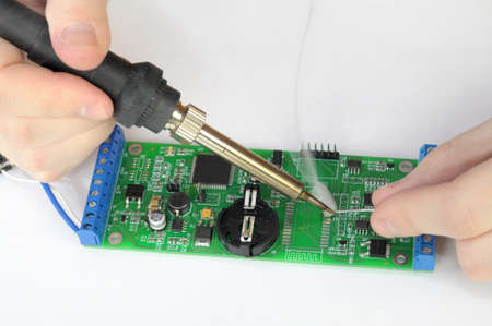 Soldering and repairing pc board with reek Stock Photo