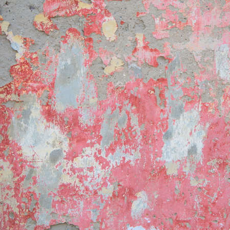 crumbling: Texture of old wall with red crumbling plaster Stock Photo