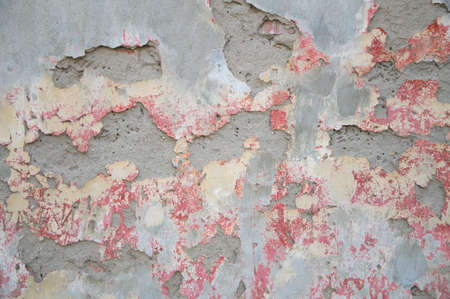 crumbling: Texture of old wall with gray, red crumbling plaster