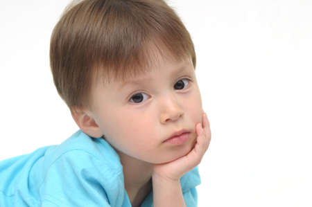 Boy looking and thinking photo
