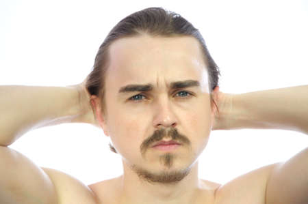 arms behind head: Attractive man  with arms behind his head isolated Stock Photo