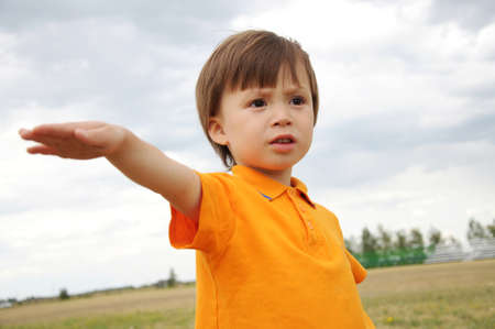 sedition: Boy with one hand up, outdoor, stadium