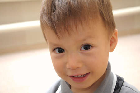 high spirited: Portrait of smiling boy looking straight at you