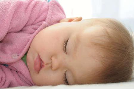quite: Baby girl in pink dress sleeping quite Stock Photo