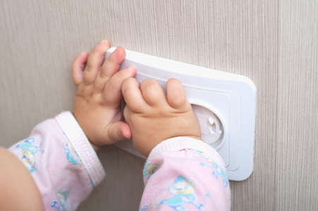 mains: electrical protection of ac power outlet for babies Stock Photo