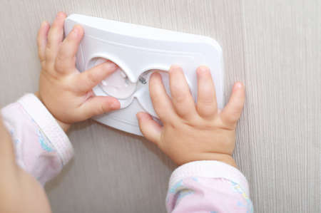 safe: electrical security of ac power outlet for babies Stock Photo