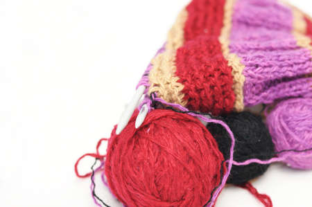 avocation: Colored woolen yarns and uncompleted handmade needle knitting Stock Photo
