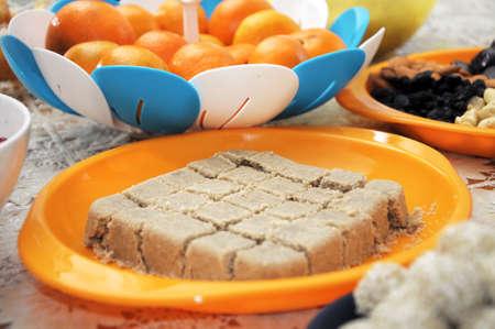 festal: halva on festive table, mandarine on background