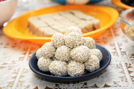 eastward: sesame balls on blue plate with  tablecloth