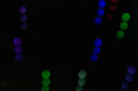 discrete: Abstract dark background with colored discrete bubbles