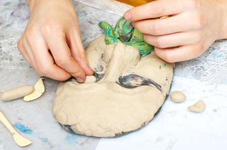 adeptness: sculpting craft with plasticine the form of face with moustache