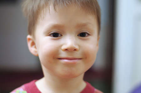 diminutive: Caucasian little boy portrait smiling at home Stock Photo