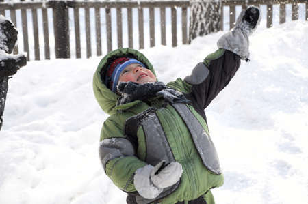 exhilaration: Boy in warm clothes in winter looking up