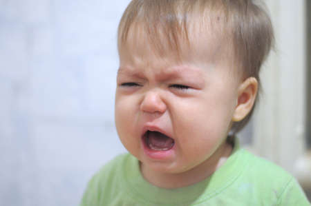 snotty: Very emotionally crying and weeping baby portrait Stock Photo
