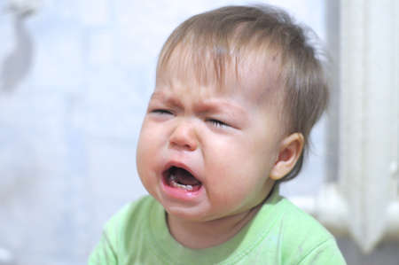 emote: Very emotionally crying and weeping baby portrait Stock Photo
