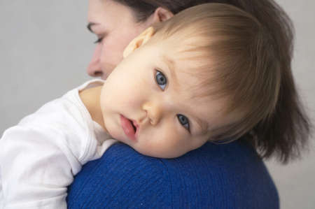 appease: Making soothe the child -baby laying head on mothers arm
