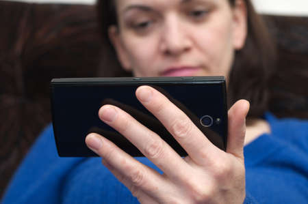 stylishness: woman hands holding  smartphone, focus on hands