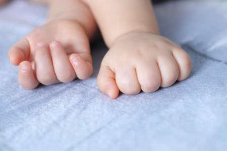 quite: Sleeping caucasian quite baby finger close up