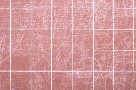 Red scholastic board background with effaced chalk marks closeup