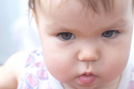 express feelings: Caucasian white Baby portrait home environment