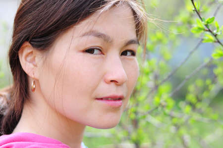 aslant: Asian woman portrait outdoor without make up Stock Photo
