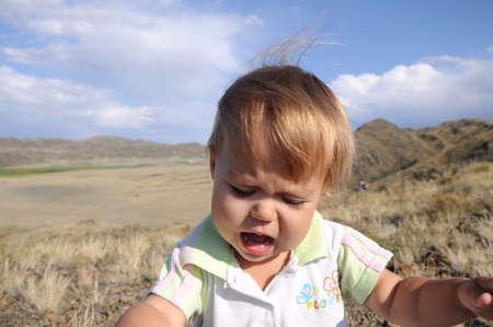 emotionally: little baby girl portrait crying very emotionally