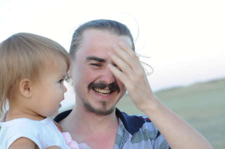 racy: Daddy with little daughter laughing very emotionally Stock Photo