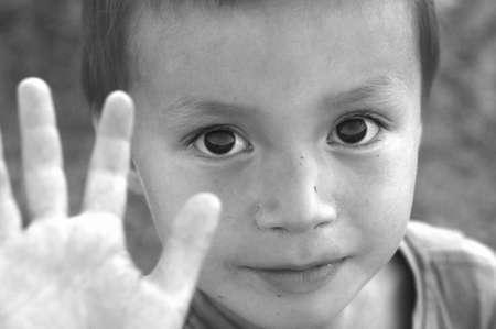 Boy saying stop black and white image Stock Photo
