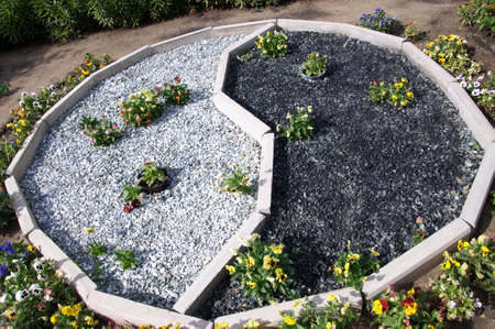 philosophic: Yin and yang in garden decoration with flowers