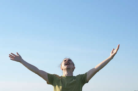 appealing: Young man screaming with open arms and appealing to the gods Stock Photo