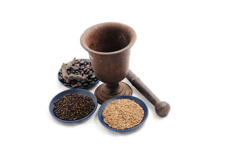 pounder: vintage pestle with flax seeds,black pepper and beans on blue plate