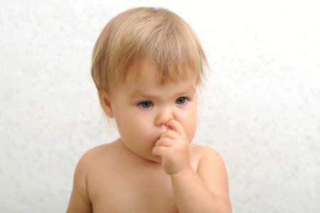 nose picking: Caucasian baby child portrait picking his nose