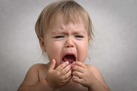 crying eyes: drama with creaming crying baby portrait very emotional Stock Photo