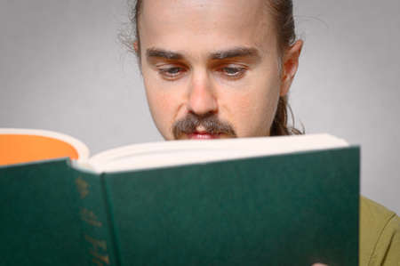 bookish: Young caucasian man student  reading literary book