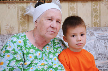 living wisdom: Grandmother and grandson portraits in a home environment