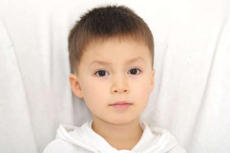 five years old: Caucasian boy portrait five years old straight look Stock Photo