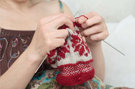 avocation: woman hands  needle knitting yarn  snowflake pattern