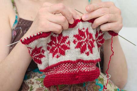 avocation: Sitting woman hands  needle knitting snowflake pattern