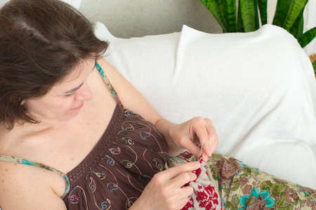 avocation: Caucasian woman needle knitting in the chair Stock Photo
