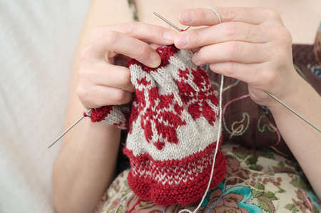 avocation: woman hands  needle knitting yarn  snowflake pattern